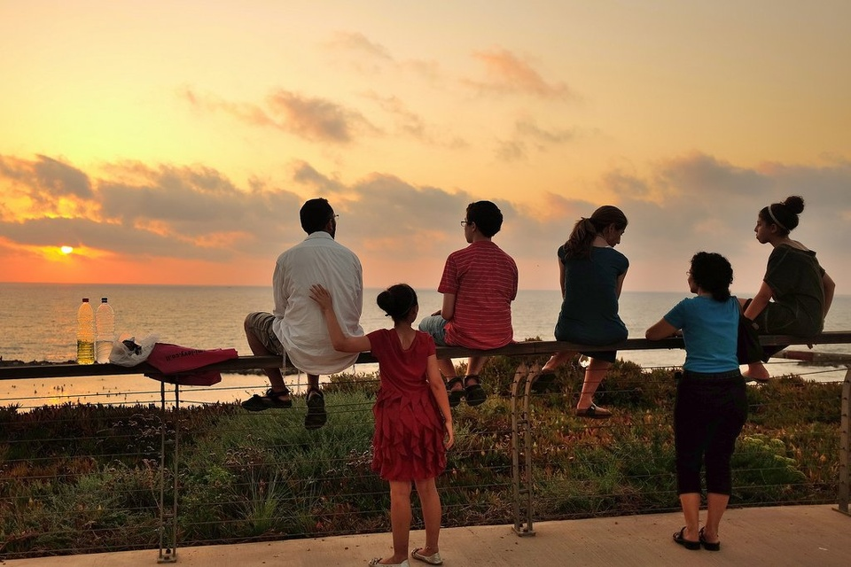 Family Hanging Out At Sunset - Teen Rehab
