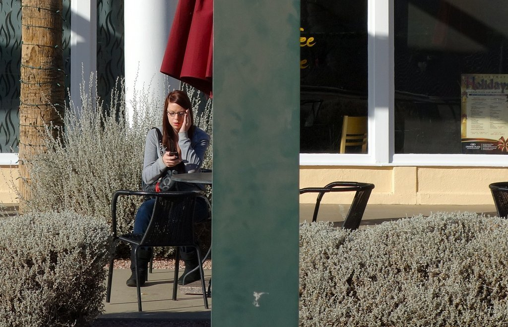 Teenage Girl Sitting At Table Outside - Teen Rehab