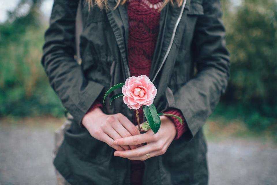 Girl Holding Pink Flower - Teen Rehab