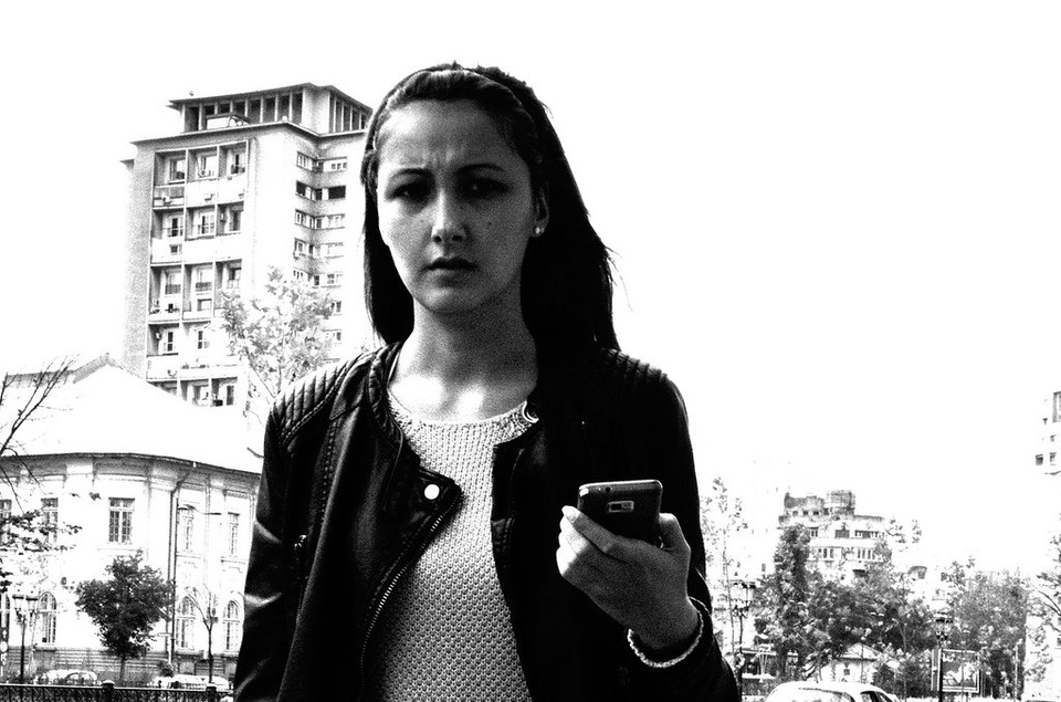 Teen Girl Looking Angrily Into Camera With Phone In Hand - Teen Rehab