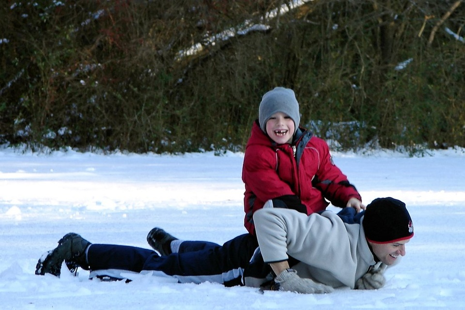 Father Son Playing In Snow - Teen Rehab
