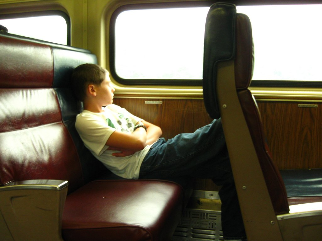 Teenage Boy Riding Train - Teen Rehab