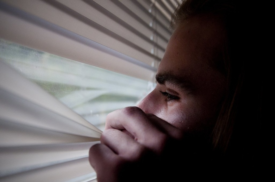 Teenager Peaking Out Window - Teen Rehab