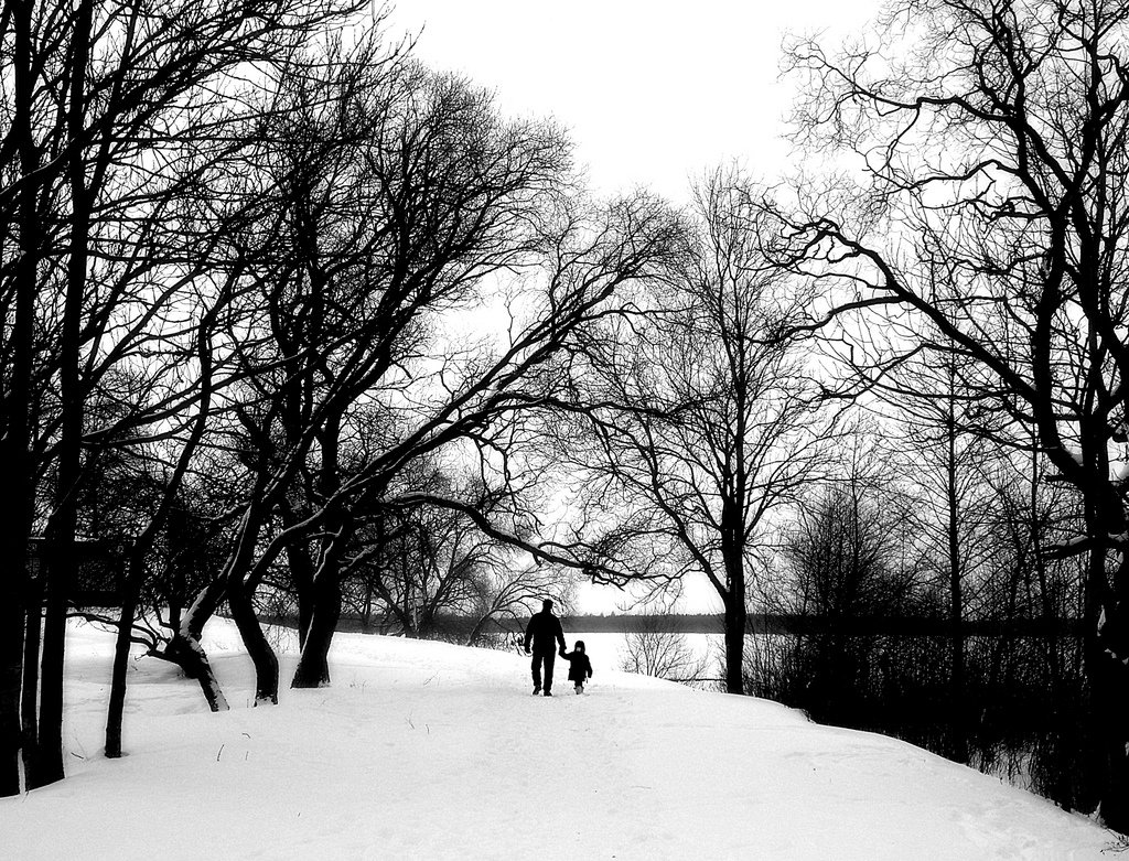 black white photograph parent child park nature snow winter