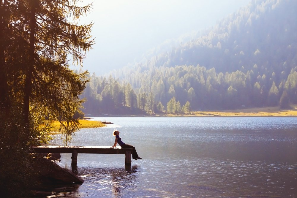 person woman dock lake water nature