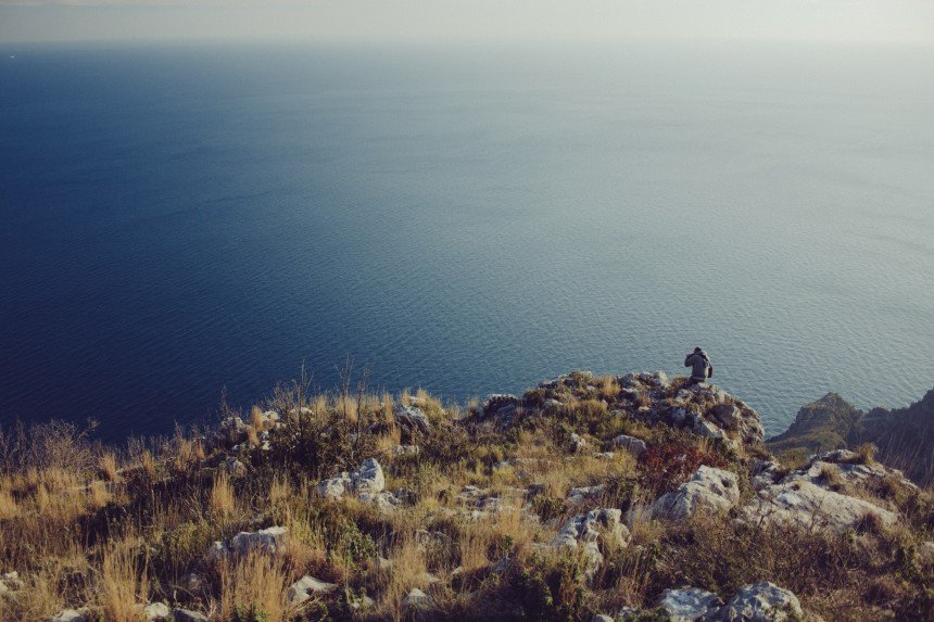Man alone on cliffs