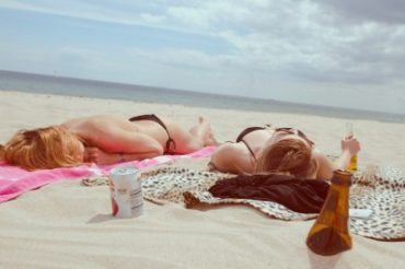 teens girls alcohol drinking beach