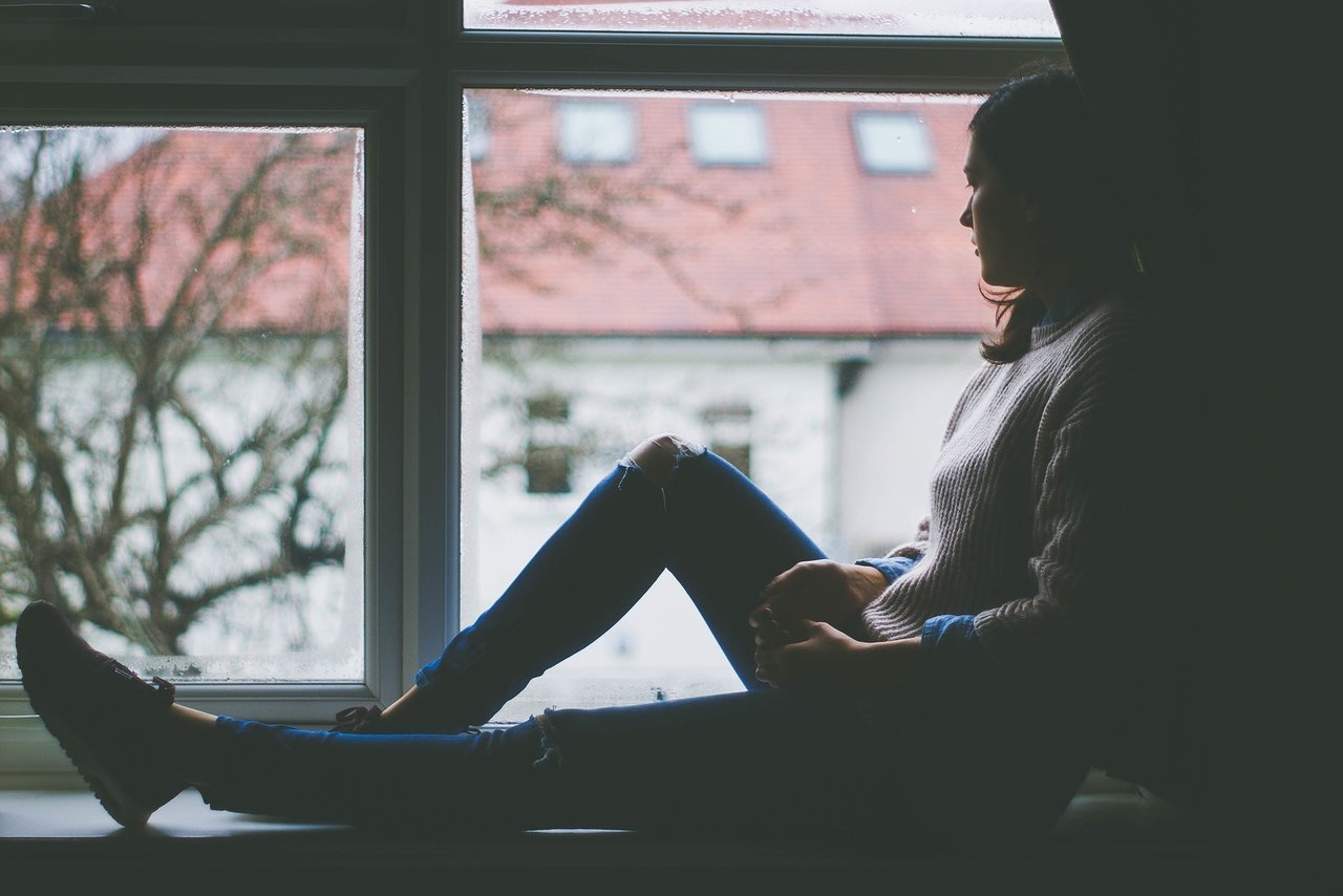 teen looking out window