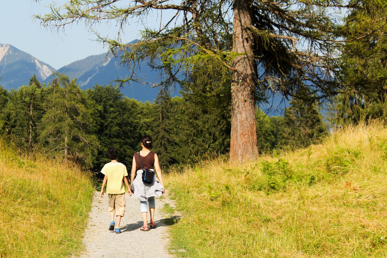 mother and child walking along a trail