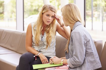 Depressed College Student Talking To Counselor
